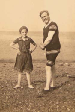 W. H. G. T. playing with his daughter at the beach. Click for enlarged image.
