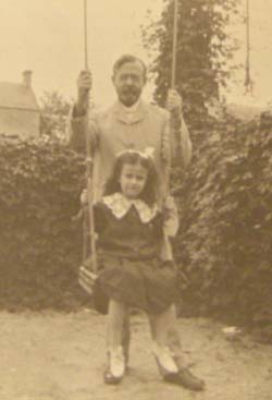 W. H. G. T. pushing Winifred in a swing. Click for enlarged image.