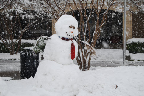 Image of snowman outside library Feb 2010